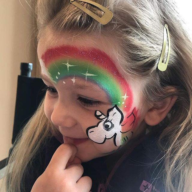 Rainbow unicorn face paint by Vibrant Events. Children's entertainers in Kent.