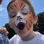 Vibrant Events tiger face paint. Professional face painting in Kent.