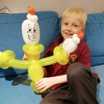 Theo with balloon model. Vibrant Events